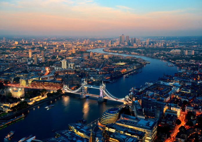 London aerial view panorama blended with sunset and night with urban architectures