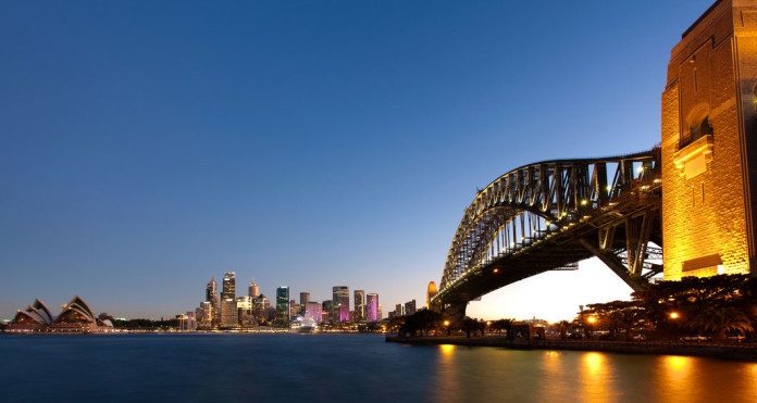 Sydney Harbour at dusk, with bridge on foreground