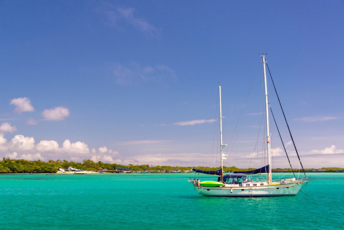 Yacht in the harbour of Puerto Villamil at Isabela Island in the Galapagos Islands in Ecuador
